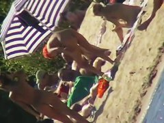 Sexy people on the beach having fun voyeur video