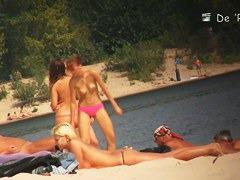 Naked hotties followed around by a nude beach voyeur