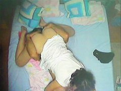 Spy cam catches a cheating couple having sex