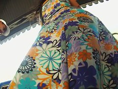 Cutie in a flowery dress makes for hot upskirt magic