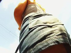 Blonde bombshell lets a voyeur stick a cam up her skirt
