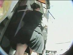Curvy  MILF lets a voyeur put a cam up her skirt