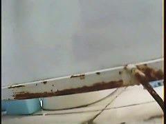 Porno of a Skinny white lady filmed taking a clear piss by spy cam
