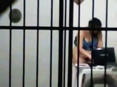 sexy brunette masterbates in a cell behind bars while on her laptop porn
