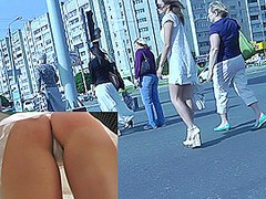 Nice upskirt pussy pics of a dark-haired bombshell