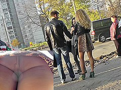 Blonde was waiting a bus and caught on upskirt camera