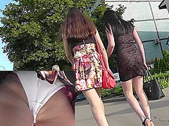 Slender chick shows white panties on the upskirt camera