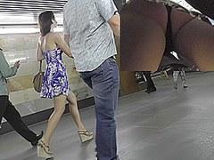 Dark-haired slender girl in the free upskirt video