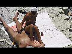 Now girlfriend masturbate him and helped cum on the beach