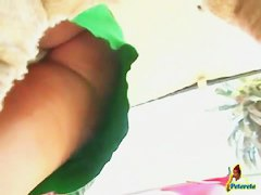 Tropical upskirt porn of a hot mama in a green tight dress showin ass n pus