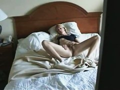 Blonde solo masterbating on a king sized bed rubbin in circles