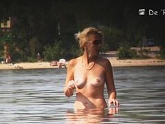 Teen girls in panties get their tits on beach voyeur video