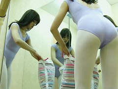Asian teen admires her reflection in huge mirrors on spy cam