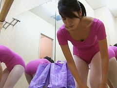 A fresh Japanese ballet dancer is taking off her training suit and putting on her casual wear.