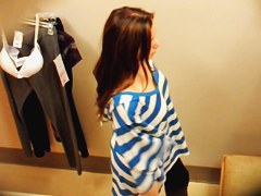 Amateur in dressing room lost off top and showed nude tits