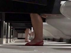 Under toilet stall voyeur