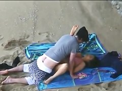 Beach candid camera shows slut having sex