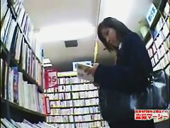 Asian gal slides hand in panty and masturbates on hidden cam