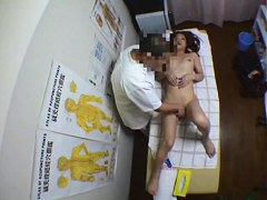 A girl gets some pussy and tits massage in the medical room.
