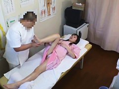 The Asian chick is getting massage voyeur sex in the parlor