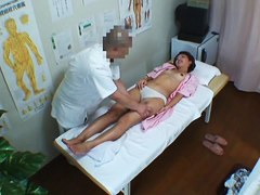 Asian girl gets naked and pussy fucked by masseur on spy cam