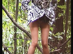 Candid girl in pantyhose was caught pissing in the wood