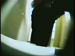 Big round ass of girl pissing approaches to the spy camera