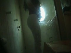 Spy cam sexy girl wearing on thong and pants after pissing