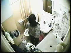 Real babe pissed and looked into mirror on hidden cam