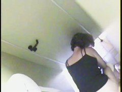 Real amateur fem was caught from above pissing on toilet