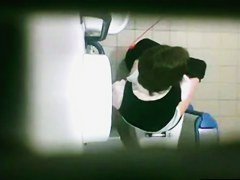 Female is pissing on toilet and getting shot from above