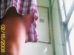 Girl in short checked outfit flashes pussy on the toilet cam