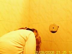 Girl pissing in toilet gets cellulites booty voyeured