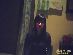 Brunette amateur calmly sitting on toilet waiting to piss