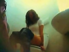 Amateur girl sitting motionless when pissing on toilet