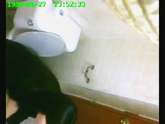 One girl pissing on toilet after another on the spy cam
