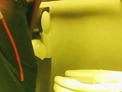 Girl sat pissing on toilet and flashed the booty view