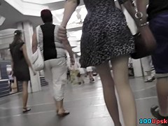 Babe walks with a guy and gets caught on upskirt camera