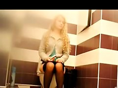 Long haired blonde hitches skirt and pulls down tights
