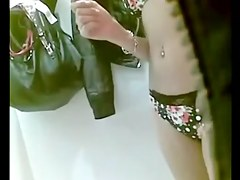 Teen in dressing room wearing swimsuit 2