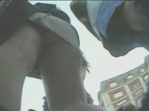 Big bum in white skirt is shown on a hidden spy cam