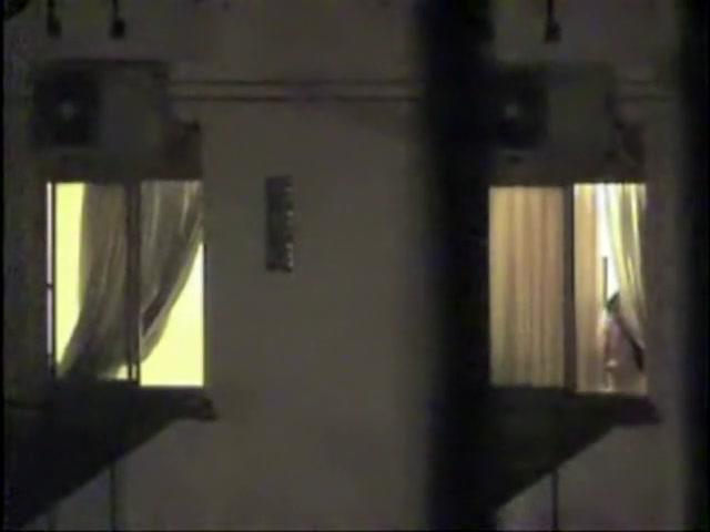 Naked bimbo at the window spied on cam by the neighbor
