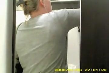 Spy cam woman in change room choosing the brassiere