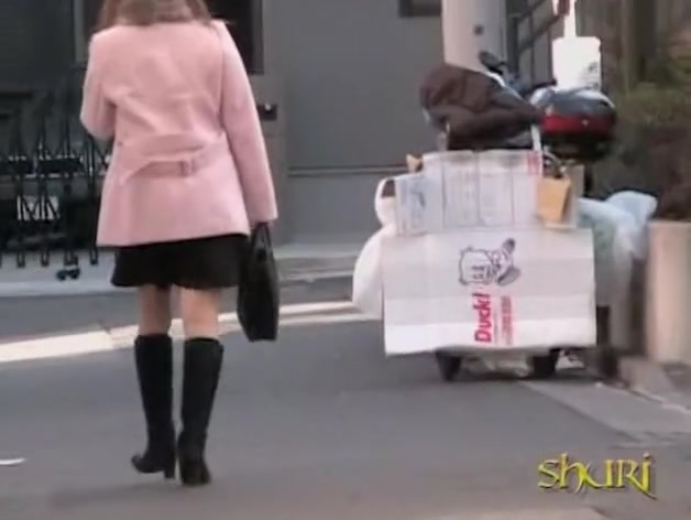 Cute Asian babe in a pink jacket gets a street sharking.