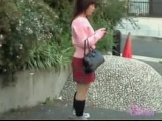 Cute Japanese girl in a smutty sharking video in public