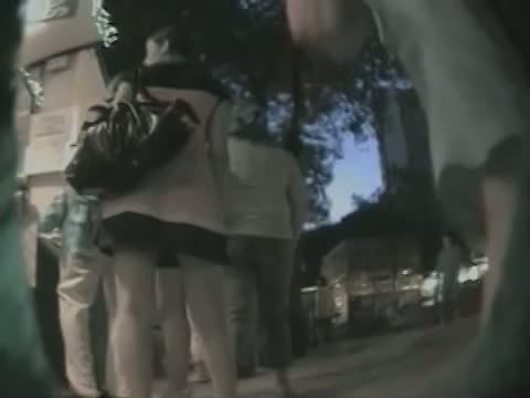 Evening upskirt view in a public place with chick