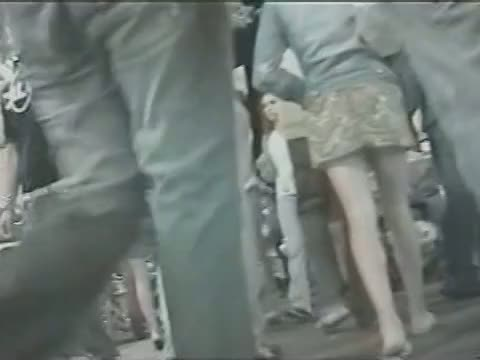 Upskirt voeyer videos show yummy town butts in short skirts.