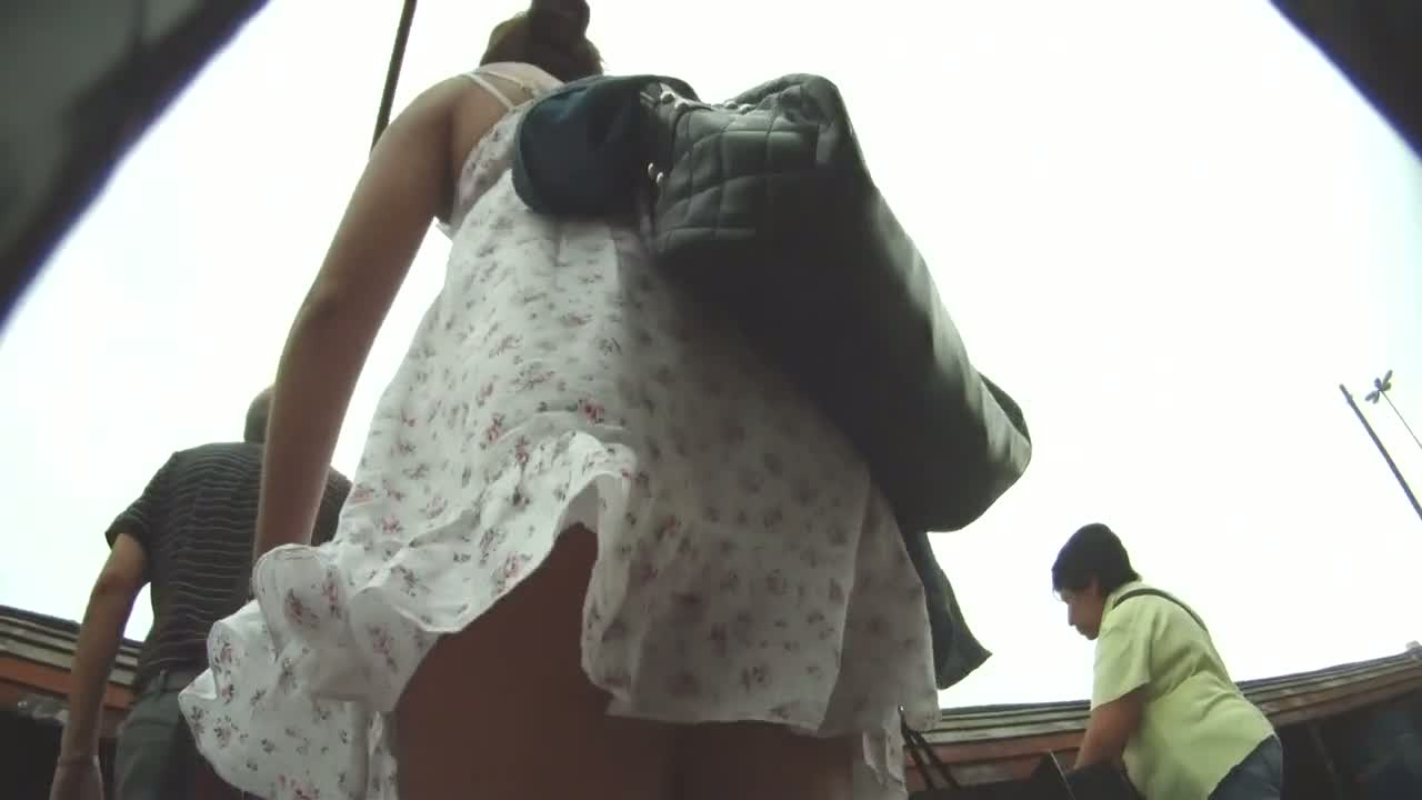 Cute brunette in summery white dress gives amazing upskirt view
