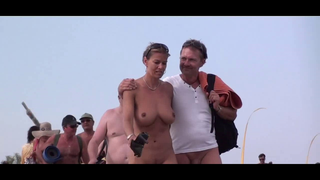 French nudist beach Cap d'Agde people walking in nature's garb 02