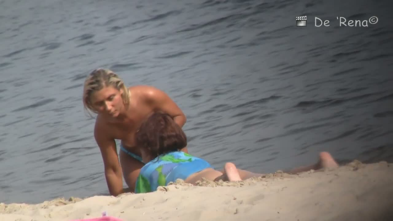 Public beach topless blonde voyeur video